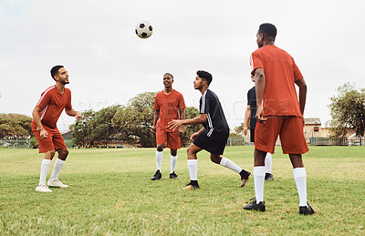 Buy stock photo Shot of young soccer players playing together on a field