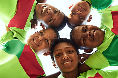 Buy stock photo Portrait of a boys soccer team standing together in a huddle