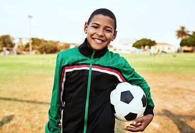 Buy stock photo Portrait of a young boy playing soccer on a sports field