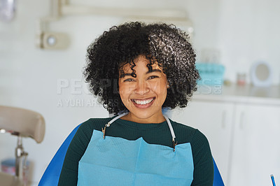 Buy stock photo Shot of a happy young woman sitting in a dentist's chair