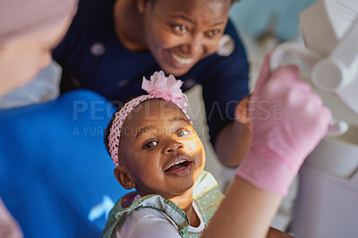 Buy stock photo Shot of an adorable little girl having dental work done on her teeth