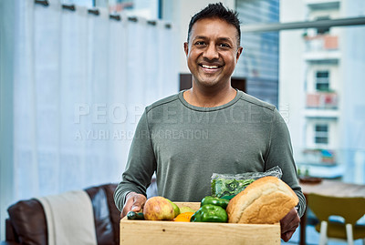 Buy stock photo Shot of a man having groceries delivered to his home
