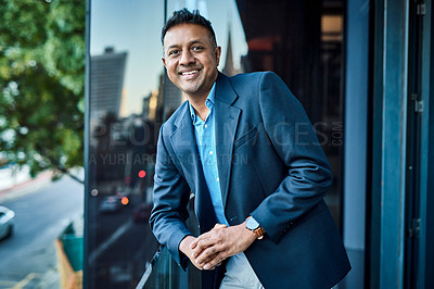 Buy stock photo Portrait of a confident businessman standing on an office balcony
