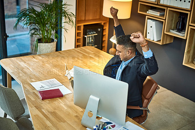Buy stock photo Shot of a businessman stretching while using a laptop at his desk in a modern office