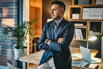 Buy stock photo Shot of a businessman looking thoughtful while working in a modern office