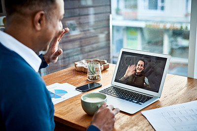 Buy stock photo Shot of a businessman having a video call with his colleague while working from home