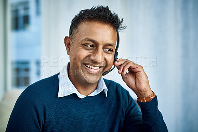 Buy stock photo Shot of a businessman using a headset while working from home