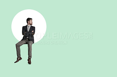 Buy stock photo Shot of a businessman looking thoughtful at a graph against a green background