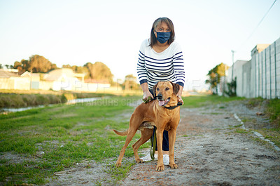 Buy stock photo Shot of a mature woman taking her dog for a walk