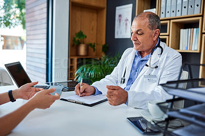 Buy stock photo Shot of a mature doctor having a consultation with a woman