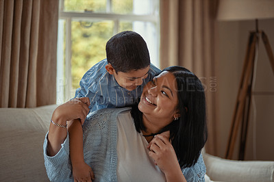 Buy stock photo Shot of a young woman and her son spending quality time together at home