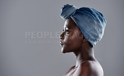 Buy stock photo Shot of a beautiful young woman wearing a denim head wrap while posing against a grey background