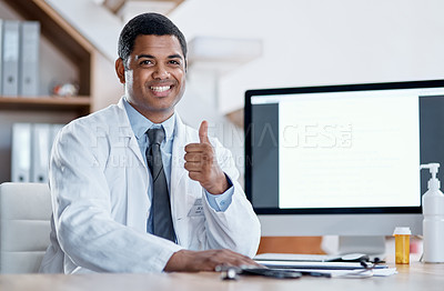 Buy stock photo Portrait of a young doctor showing thumbs up in his office