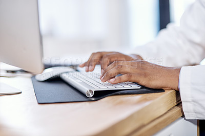 Buy stock photo Closeup shot of an unrecognisable doctor working on a computer