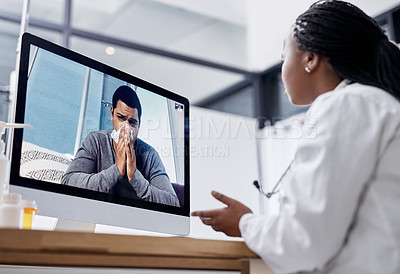 Buy stock photo Shot of a young man blowing his nose during a video call with a doctor on a computer