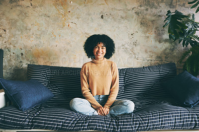 Buy stock photo Portrait of if a young woman relaxing on a sofa at home