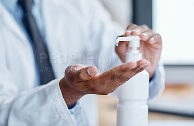 Buy stock photo Closeup shot of an unrecognisable doctor using hand sanitiser in a hospital