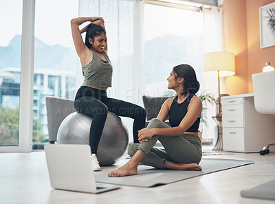 Buy stock photo Shot of two young women working out at home