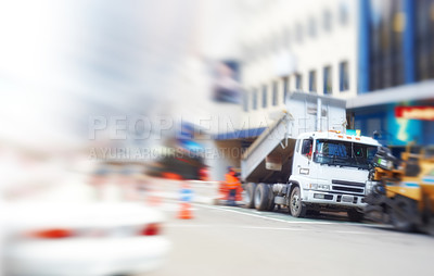 Buy stock photo An illustrative lens and motion blurred image of city life