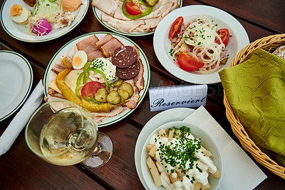 Buy stock photo Shot of a spread of various traditional Austrian food at a restaurant