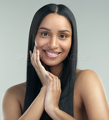 Buy stock photo Cropped shot of a beautiful young woman with flawless skin posing against a grey background