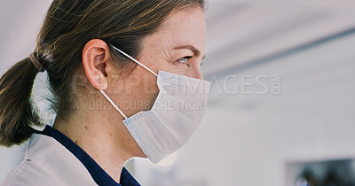 Buy stock photo Shot of a young woman wearing a mask in a lab