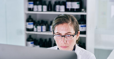 Buy stock photo Shot of a young woman working on a computer in a lab