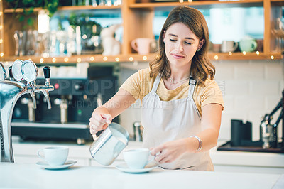 Buy stock photo Shot of a young woman preparing coffee in a cafe