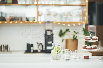Buy stock photo Shot of a cupcake stand on a cafe counter