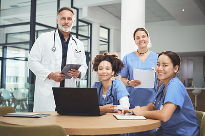 Buy stock photo Portrait of a team of doctors having a meeting in a hospital