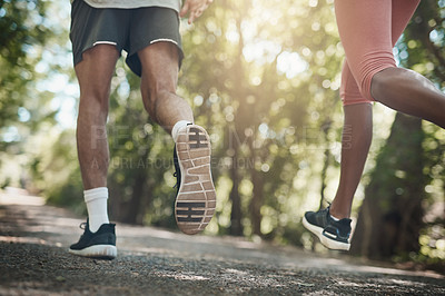 Buy stock photo Shot of two unrecognizable people running outdoors