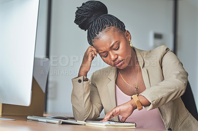 Buy stock photo Shot of a young businesswoman stressed woman sitting at her desk in her office