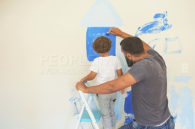 Buy stock photo Shot of a man and his son painting a room blue at home