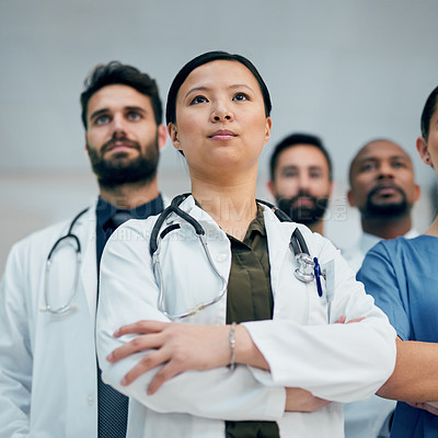 Buy stock photo Low angle shot of a group of medical practitioners standing in the hospital