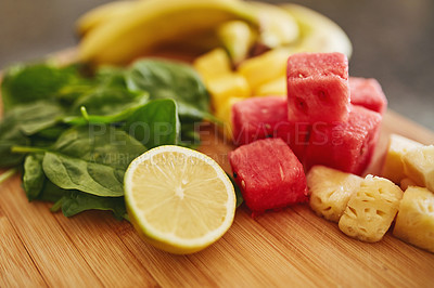 Buy stock photo Shot of freshly cut vegetables on a cutting