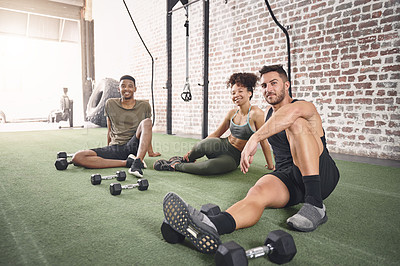 Buy stock photo Shot of a fitness group resting after working out with dumbbells