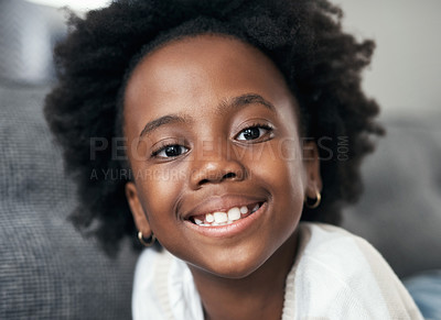 Buy stock photo Shot of an adorable little girl lying on the couch at home