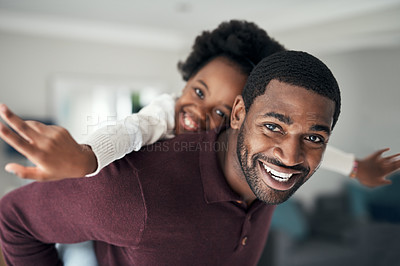 Buy stock photo Shot of a man carrying his young daughter on his back