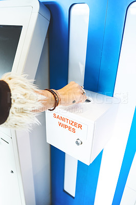 Buy stock photo Cropped shot of a person using the sanitiser wipes at the airport