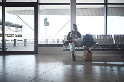Buy stock photo Shot a young woman sitting with a bags in the airport