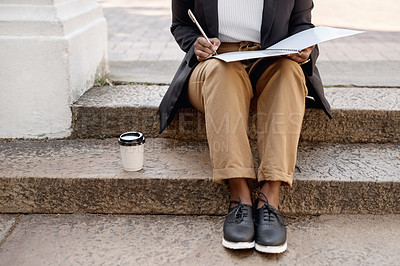 Buy stock photo Closeup shot of an unrecognisable businesswoman going through paperwork while sitting on a staircase outdoors
