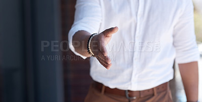 Buy stock photo Closeup shot of an unrecognisable businessman extending a handshake outside an office