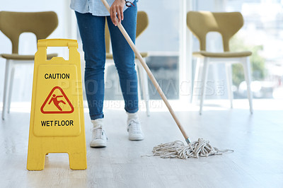 Buy stock photo Shot of an anonymous woman mopping her floors at home