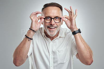 Buy stock photo Studio portrait of a mature man wearing spectacles against a grey background