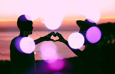 Buy stock photo Cropped shot of an affectionate young couple silhouetted at sunset