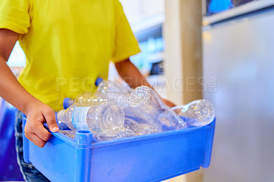 Buy stock photo Cropped shot of a boy carrying a container with bottles at home