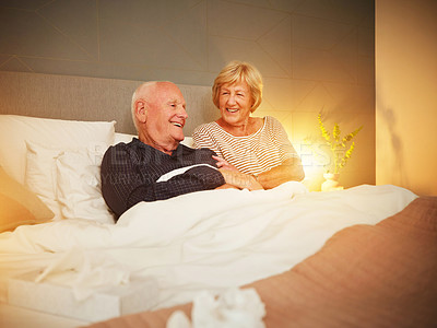 Buy stock photo Shot of an elderly woman taking care of her husband at home