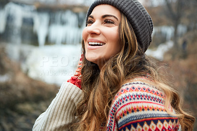 Buy stock photo Cropped shot of an attractive young woman spending the day outside during winter