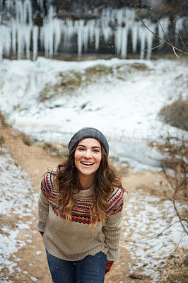 Buy stock photo Cropped portrait of an attractive young woman spending the day outside during winter