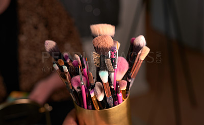 Buy stock photo Shot of makeup brushes in a container on a table backstage